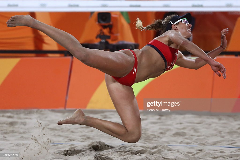 April Ross of United States plays a shot during a Women's Quarterfinal match between the United States and Australia on Day 9 of the Rio 2016 Olympic Games at the Beach Volleyball Arena on August 14, 2016 in Rio de Janeiro, Brazil.