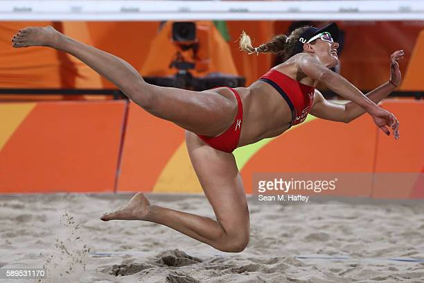 April Ross of United States plays a shot during a Women's Quarterfinal match between the United States and Australia on Day 9 of the Rio 2016 Olympic...
