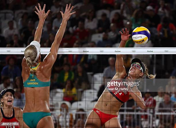 April Ross of United States spikes the ball against Louise Bawden of Australia during a Women's Quarterfinal match between the United States and...