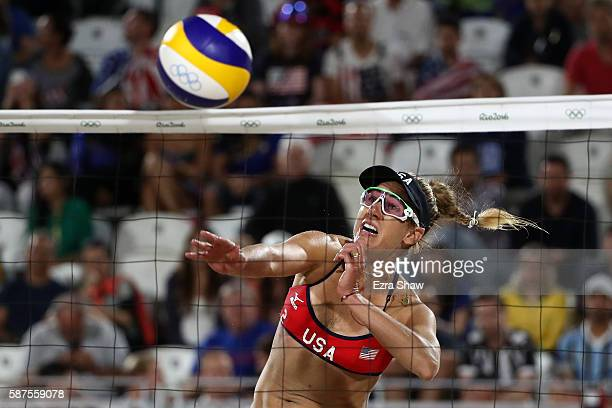 April Ross of United States spikes the ball during the Women's Beach Volleyball preliminary round Pool C match against Fan Wang and Yuan Yue of China...