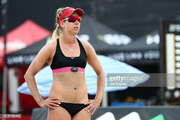 April Ross prepares to receive during her round of 32 match against Annika and Teegan Van Gunst AVP Manhattan Beach Open on August 17 2018 in...