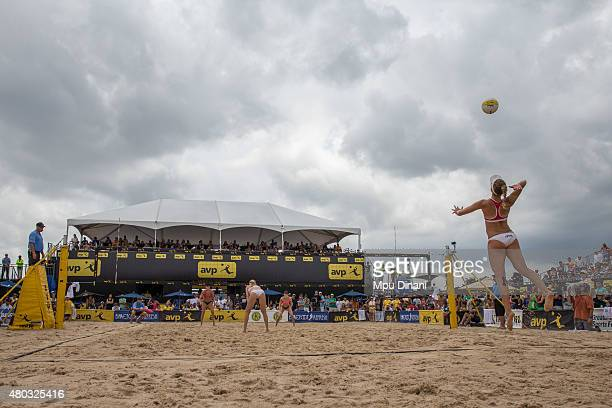 April Ross serves to Emily Day and Jennifer Kessy as Kerri WalshJennings looks on at the AVP New Orleans Open at Laketown on May 24 2015 in Kenner...