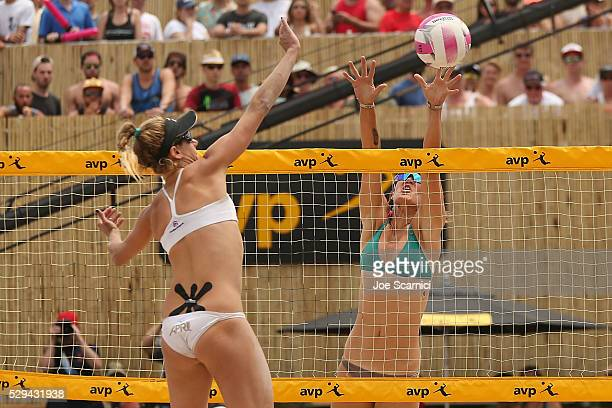 April Ross spikes the ball past Angela Bensend during the final match at AVP Huntington Beach Open on May 08 2016 in Huntington Beach California