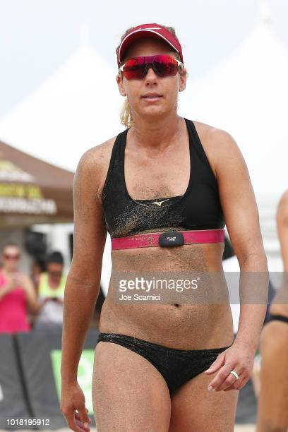 April Ross walks to her bench after beating Teegan and Annika Van Gunst in the round of 32 at the AVP Manhattan Beach Open on August 17 2018 in...