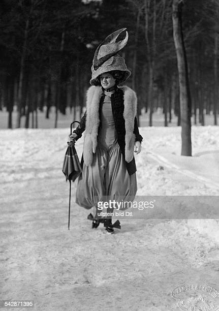 Aprilfool hoax Winter pictures Lady in a pantsuit with bloomers a fur stole and an extravagant hat walking in the snow undated probably 1930...