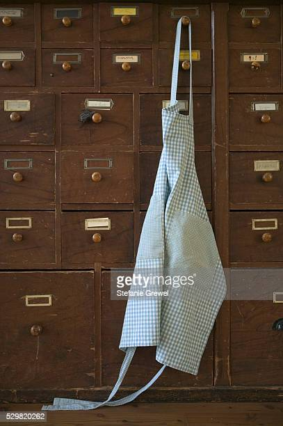 Apron Hanging on Set of Storage Drawers