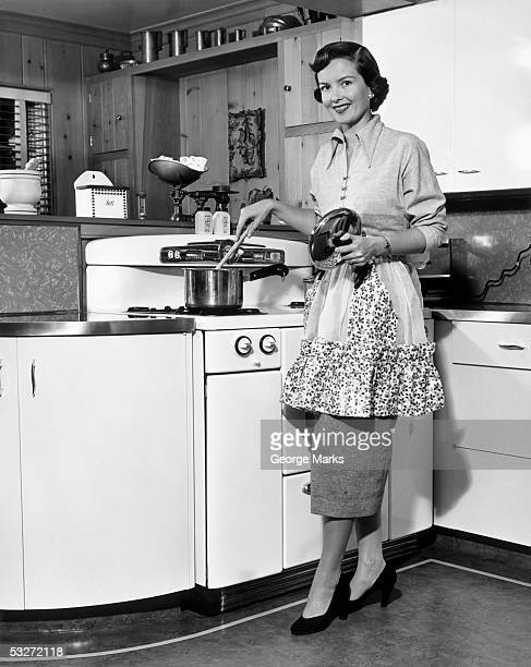 Apron housewife at kitchen stove