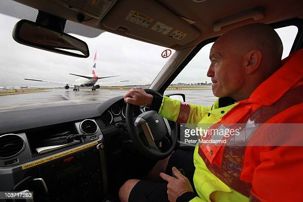 Apron Officer Bob Baker drives near a taxiing aircraft at Heathrow airport on August 27 2010 in London England Heathrow's 66000 employees will...