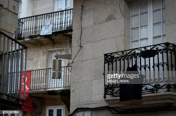 Aprons hang from balconies to support a one day strike to defend women's rights on International Women's Day in Vigo on March 8 2018 Spain celebrated...
