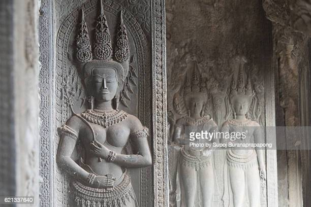 apsara angle on the wall of angkor wat , siem reap , cambodia - apsara stock photos and pictures