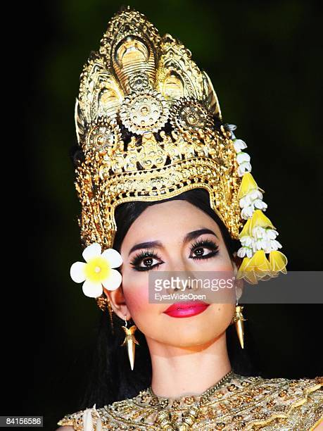 Apsara dancer with headdress performing at the show The Legend of Angkor Wat When history comes to life in front of the famous Angkor Wat temple in...