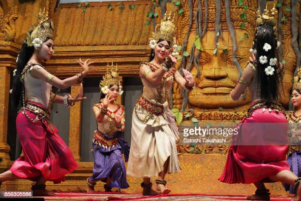 Apsara dancers perform a traditional apsara dance at a stage