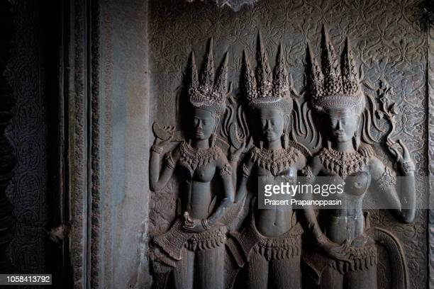 apsara statue in angkor wat - apsara stock photos and pictures