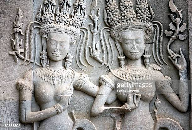 Apsaras or divine dancers are engraved on reliefs in Angkor Wat temple on October 6 2009 in Angkor Cambodia Angkor Wat is a temple complex at Angkor...