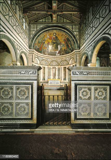 Apse with mosaic of Redeemer between Virgin Mary and St Minias basilica of San Miniato al Monte , Florence , Tuscany. Italy, 13th century.