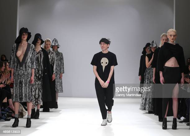 Apu Jan walks the runway at the Apu Jan show at the Fashion Scout venue during London Fashion Week AW14 at Freemasons Hall on February 16 2014 in...