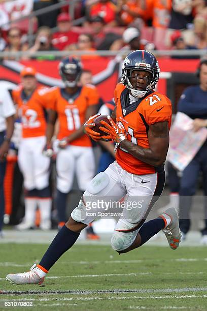 Aqib Talib of the Broncos intercepts a pass and then looks for some open running room during the NFL game between the Denver Broncos and Tampa Bay...