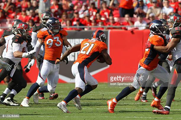 Aqib Talib of the Buccaneers intercepts a pass and runs back upfield during the regular season game between the Denver Broncos and the Tampa Bay...