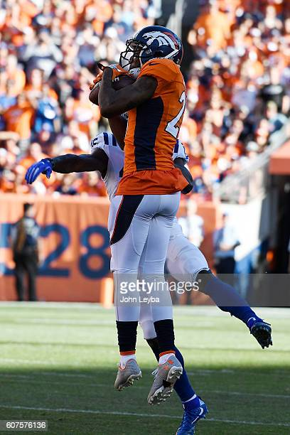 Aqib Talib of the Denver Broncos makes a picksix on a ball thrown by Andrew Luck of the Indianapolis Colts intended for Phillip Dorsett during the...