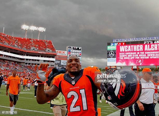 Aqib Talib of the Denver Broncos plays to the fans as he and players from both teams leave the field because of bad weather during the fourth quarter...