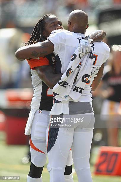 Aqib Talib of the Denver Broncos shares a moment with Adam Jones of the Cincinnati Bengals before their game at Paul Brown Stadium on September 25...