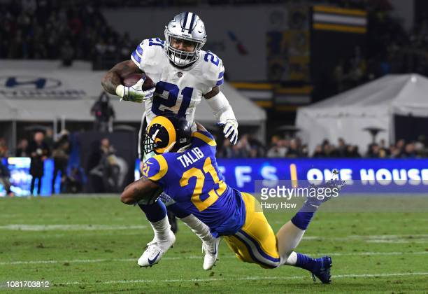 Aqib Talib of the Los Angeles Rams tackles Ezekiel Elliott of the Dallas Cowboys in the second quarter in the NFC Divisional Playoff game at Los...