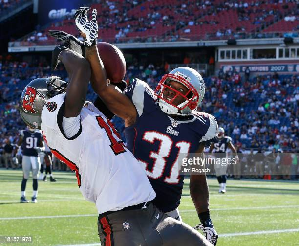 Aqib Talib of the New England Patriots breaks up a pass intended for Mike Williams of the Tampa Bay Buccaneers during the 4th quarter in a game at...