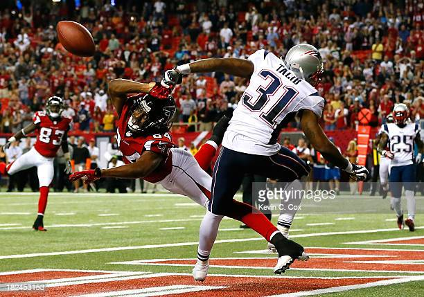 Aqib Talib of the New England Patriots breaks up a touchdown reception intended for Roddy White of the Atlanta Falcons in the final seconds at...