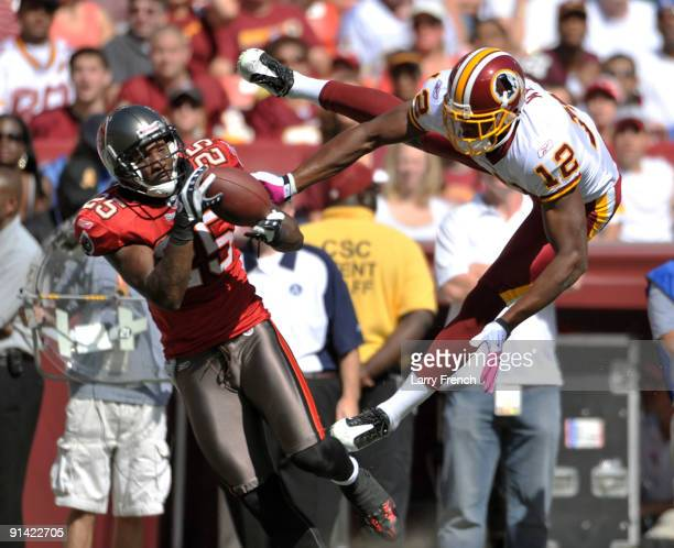 Aqib Talib of the Tampa Bay Buccaneers intercepts the ball against Malcolm Kelly of the Washington Redskins at FedExField on October 4 2009 in...