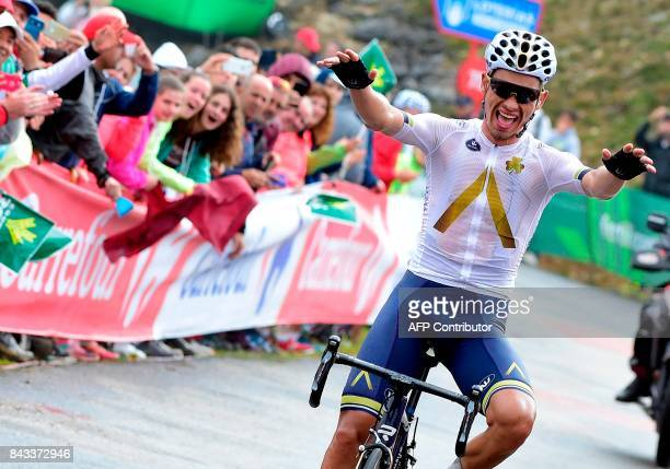 Aqua Blue's Austrian Stefan Denifl celebrates as he crosses the finish line of the 17th stage of the 72nd edition of 'La Vuelta' Tour of Spain...