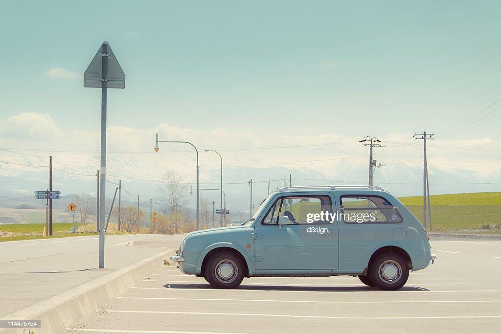Aqua color car in parking lot : ストックフォト