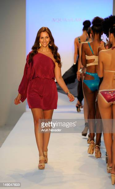 Aqua Di Lara designer Reyhan Sofraci walks the runway during the finale of the Aqua Di Lara fashion show at Raleigh Hotel on July 21, 2012 in Miami...