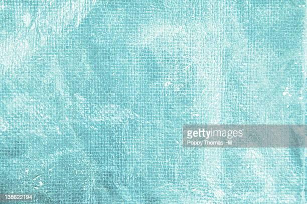 Aqua wrinkled plastic tarp