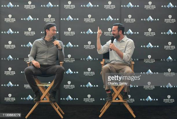 Aquaman producer Peter Safran and tour guide John Kourounis speak onstage during the Warner Bros Studio Tour Hollywood Aquaman Exhibit reveal on...
