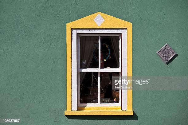 Aquamarine colour wall and yellow window border in Kinsale County Cork Ireland