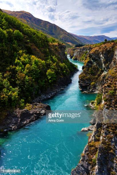 aquamarine kawarau river on summer afternoon outside queenstown, new zealand, downstream of original commercial bungy jumping site - otago region stock pictures, royalty-free photos & images