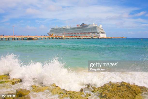 Aquamarine waters of Caribbean Sea near cruise ship and pier