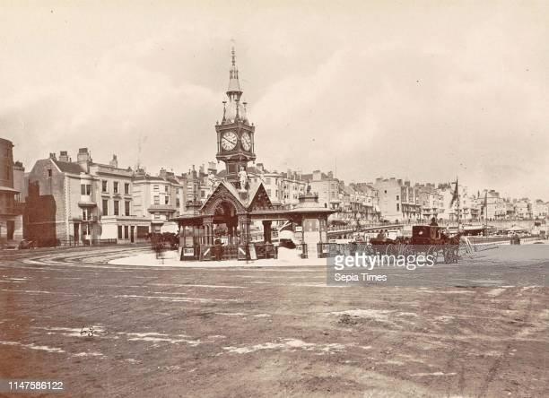 Aquarium Clock Tower Brighton waiting beside horse carriages UK Anonymous 1878 1890