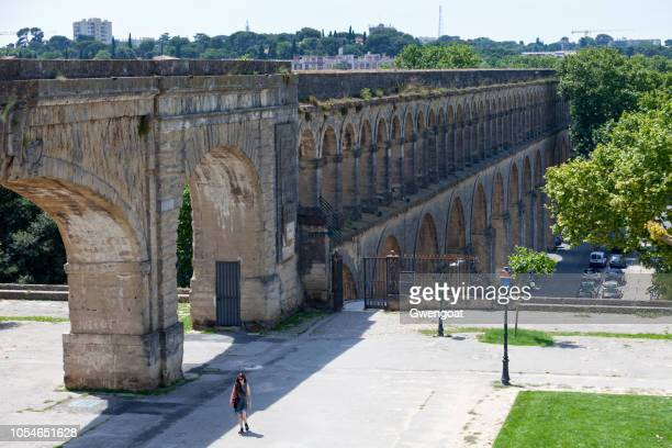 aqueduct saint-clément in montpellier - montpellier stock pictures, royalty-free photos & images