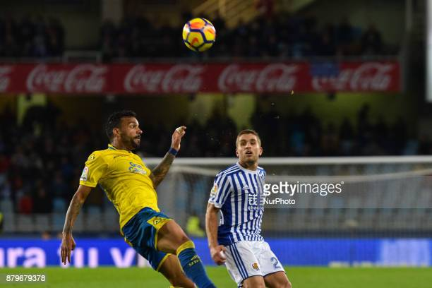 Aquilani of U D Las Palmas duels for the ball with Kevin Rodrigues of Real Sociedad during the Spanish league football match between Real Sociedad...