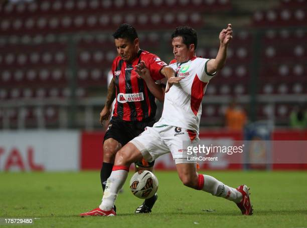 Aquiles Ocanto od Deportivo Lara conducts the ball during a match between Deportivo Lara and Liga de la Loja as part of the Copa Total Sudamerican at...