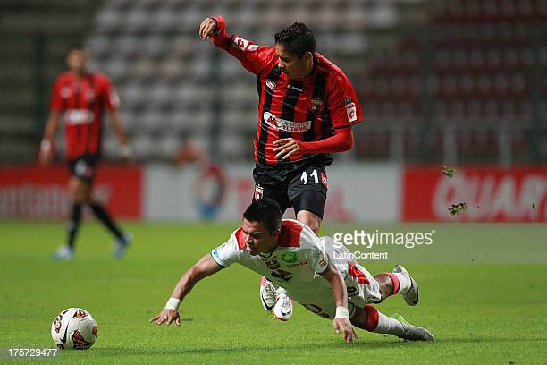 Aquiles Ocanto of Deportivo Lara conducts te ball during a match between Deportivo Lara and Liga de la Loja as part of the Copa Total Sudamerican at...