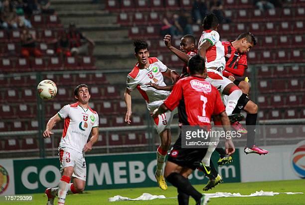 Aquiles Ocanto of Deportivo Lara struggles for the ball with Jonny Uchuari of Liga de la Loja during a match between Deportivo Lara and Liga de la...
