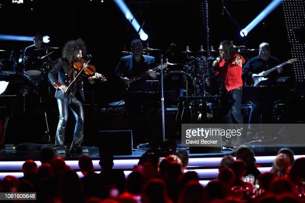 Ara Malikian and Draco Rosa perform onstage at the Person of the Year Gala honoring Mana during the 19th annual Latin GRAMMY Awards at the Mandalay...