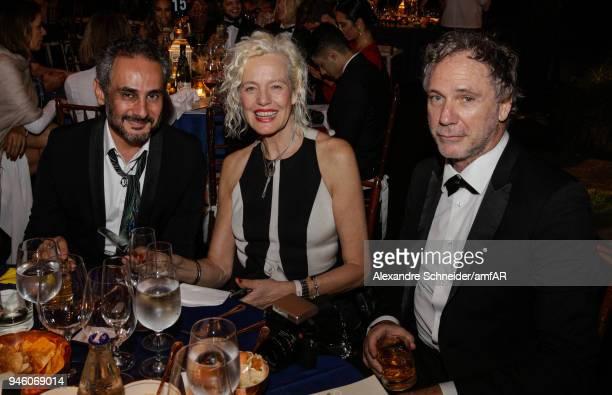 Ara Vartanian Ellen Von Unwerth and Oskar Metsavaht attend the 2018 amfAR gala Sao Paulo at the home of Dinho Diniz on April 13 2018 in Sao Paulo...