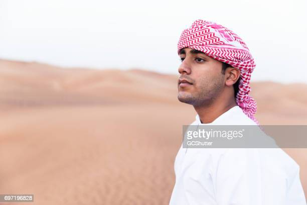 arab admiring the the dunes of arabia - qatar desert stock photos and pictures