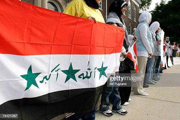 Arab Americans join hands to form a human chain as a sign of Arabic unity during a rally in front of Dearborn City Hall June 6 2007 in Dearborn...