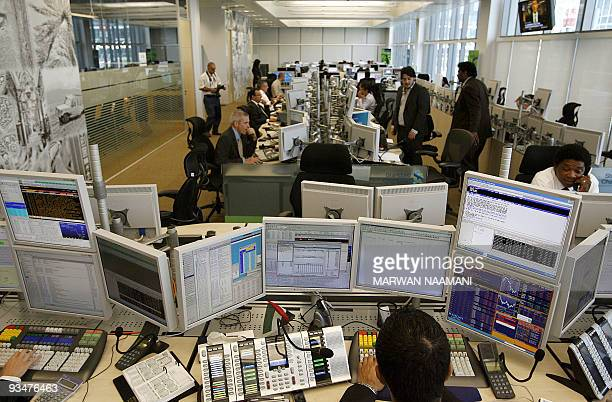 Arab and Foreign employees work at the Standard Chartered Bank's new trading room at the Dubai International Financial Center April 28 2008 Chartered...