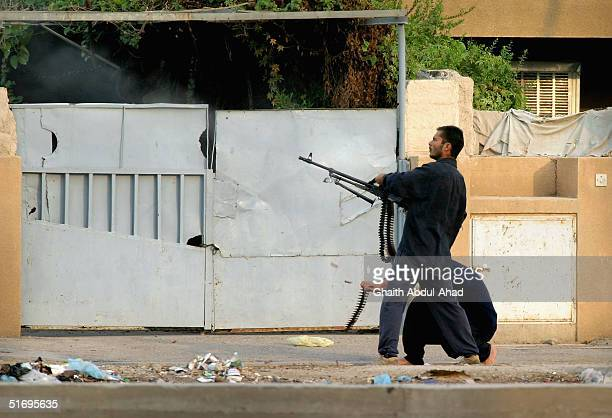Arab and Iraqi fighters fire at US positions on November 6 2004 in Fallujah Iraq The mujahadeen are preparing for a major US offensive against their...