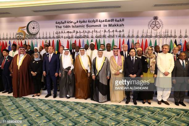 Arab and Islamic states foreign ministers pose for a family picture during a meeting of the Organisation of Islamic Cooperation and Arab League...